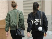 jacket,black,olive green,yeezus,bomber jacket,coat,yeezy,kendall jenner,gigi hadid,jewels,fur keychain,celebrity style,celebstyle for less,model,model off-duty,keeping up with the kardashians,olive green bomber jacket,black bomber jacket,badass