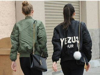 jacket black olive green yeezus bomber jacket coat yeezy kendall jenner gigi hadid jewels fur keychain celebrity style celebstyle for less model model off-duty keeping up with the kardashians olive green bomber jacket black bomber jacket badass