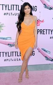 dress,orange dress,wrap dress,party dress,mini dress,bodycon dress,kylie jenner,orange,asymmetrical dress