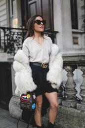 mypeeptoes,blogger,sweater,skirt,belt,coat,shoes,jewels,fur coat,gucci belt,gucci,black skirt,louis vuitton bag,backpack