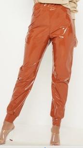 pants,vinyl,orange,tan,women,sexy,beautiful,joggers,shiny