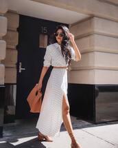dress,polka dots,side split,mid heel sandals,maxi dress,bag,belt,sunglasses