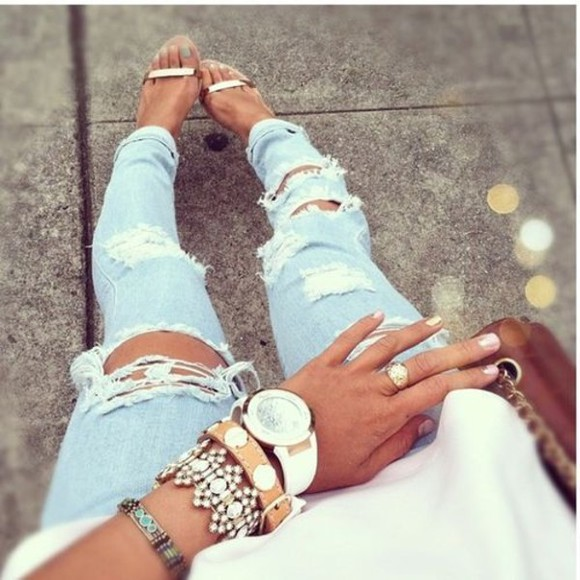 gold ring jeans ripped jeans bracelets white watch white washed denim gold shoes nail polish