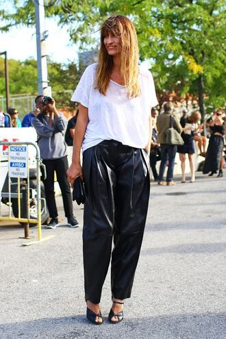 pants caroline de maigret model fashionista black pants leather pants baggy pants black leather pants t-shirt white t-shirt bag black bag streetstyle high heel sandals sandals black sandals