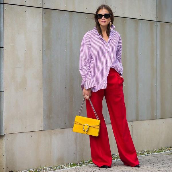 oversized stripes striped shirt wide-leg pants high waisted earrings sunglasses bag