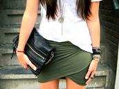 green skirt,skirt,green,asymmetrical,asymmetrical skirt,black clutch,bangle,zip,wrap skirt,bag,draped