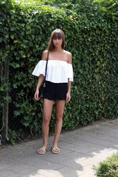 mode d'amour,blogger,bag,off the shoulder,white top,black shorts,flats,bell sleeves,white off shoulder top,top,shorts,black bag,shoulder bag,three-quarter sleeves,summer outfits,slide shoes,nude shoes