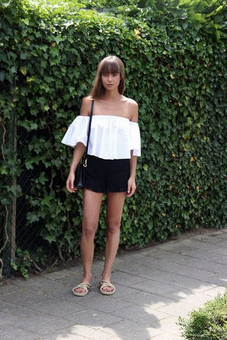 mode d'amour blogger bag off the shoulder white top black shorts flats bell sleeves white off shoulder top top shorts black bag shoulder bag three-quarter sleeves summer outfits slide shoes nude shoes