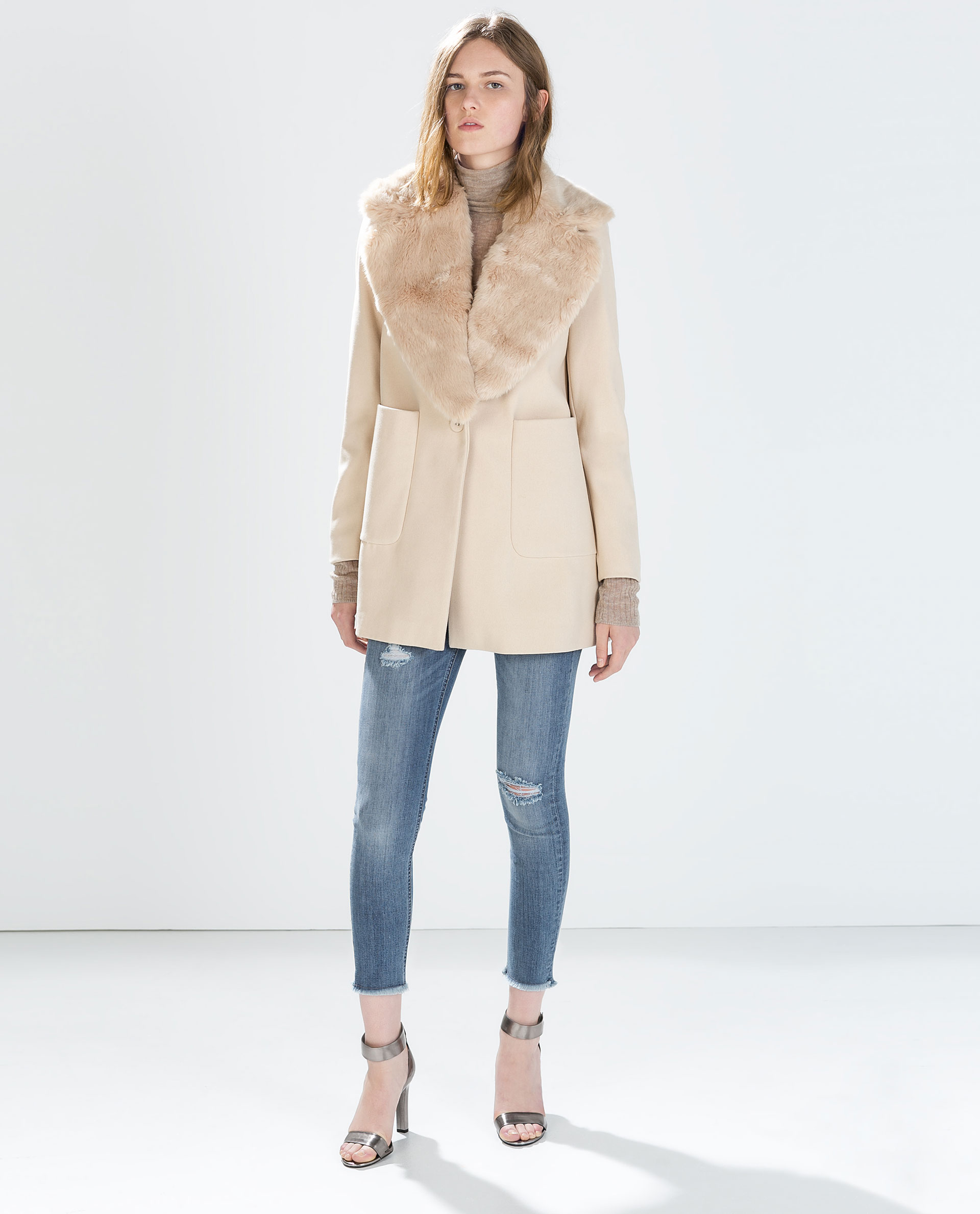 Wool coat with patch pockets and fur lapel