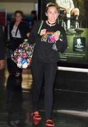sweater,sweatshirt,all black everything,miley cyrus,slide shoes,leggings,purse