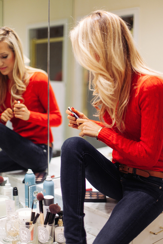 blogger krystal schlegel jeans makeup brushes red sweater