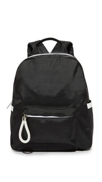 backpack white black bag