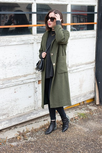 adventures in fashion blogger coat sweater jeans shoes bag sunglasses jewels green coat crossbody bag ankle boots black jeans green long coat