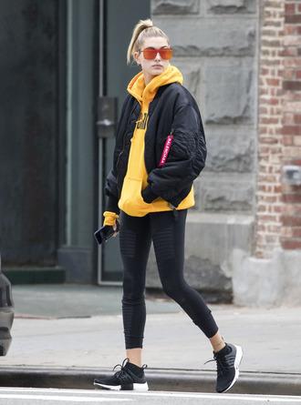 sweater hoodie yellow jacket bomber jacket sneakers leggings sunglasses hailey baldwin fall outfits streetstyle yellow sunglasses