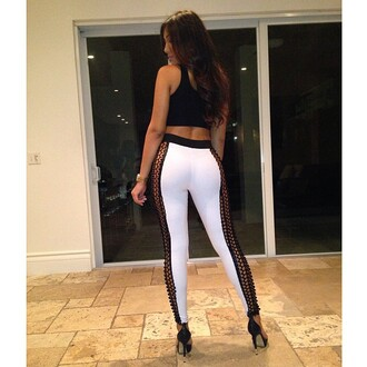 white pants pants tank top white leggings clothes fashion sequence leggings naked side white tights thighs leena sayed instagram instagram fashion high heels long hair don't care sequence net black net net pants white leggings ass tights thigh highs queen sexy sexy pants designers thin open sides swaggedout swag