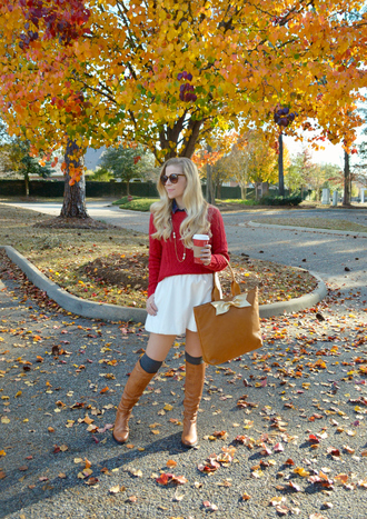fash boulevard blogger skirt tote bag brown leather boots red sweater sweater top shoes bag jewels red cable knit sweater cable knit mini skirt white skirt brown bag brown boots socks knee high socks knitted socks