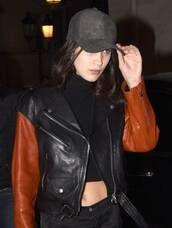 top,Bella Hadid Crop Top,crop tops,black crop top,leather jacket,jacket,bella hadid,model,baseball cap,black baseball cap
