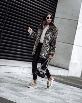 coat pants black pants sweater white sweater bag black bag leopard print fur coat furry shoes sneakers