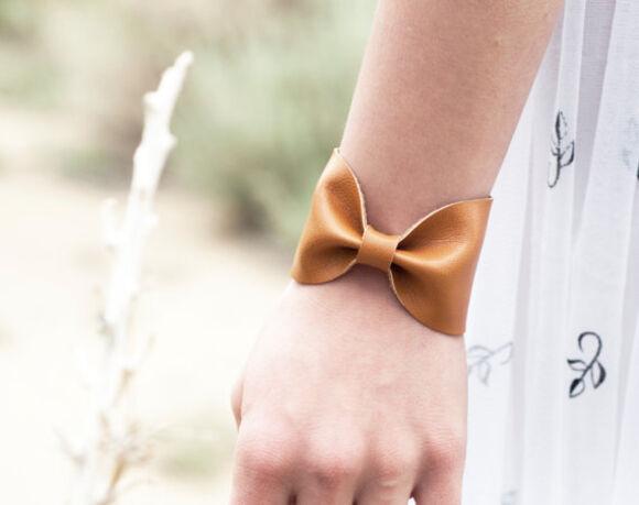 jewels bracelets cuff tattoo cover bowtie bow tie bow bracelet bow tie bracelet wide cuff bracelet wide cuff wrist caramel neutral neutral accessory accessories scarf cuff
