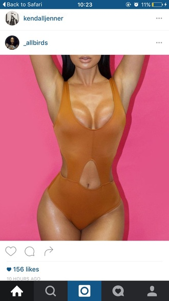swimwear sexy style scrapbook style one piece swimsuit orange cleavage one piece fashion vibe summer summer outfits sun pool party kendall and kylie jenner