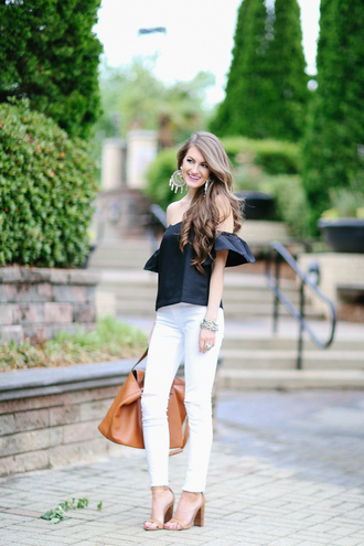 southern curls and pearls blogger jewels bag off the shoulder white jeans statement earrings brown bag blue top thick heel