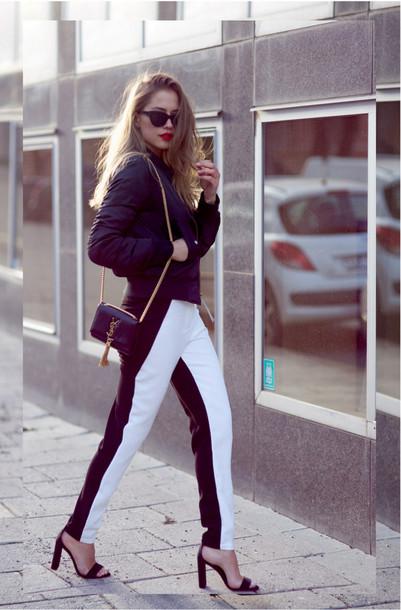 kenza blogger pants sunglasses black and white striped pants bomber jacket black sandals yves saint laurent bag