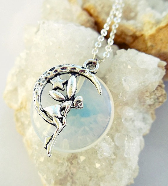 Polished opal moonstone fairy on a crescent moon necklace