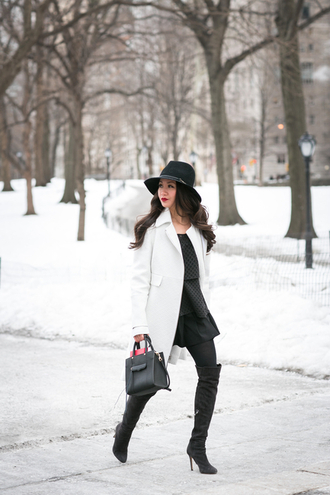 wendy's lookbook blogger hat white coat knee high boots