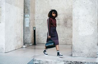 skirt fashion week street style fashion week 2016 fashion week paris fashion week 2016 printed skirt midi skirt top long sleeves burgundy burgundy top sneakers black sneakers vans sunglasses