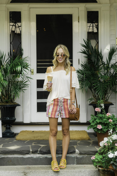 katie's bliss - a personal style blog based in nyc blogger bag sunglasses shoes shorts dress hat jewels off the shoulder white top pink sunglasses shoulder bag brown bag lace up flats yellow cut out shoulder three-quarter sleeves mirrored sunglasses striped shorts sandals flat sandals yellow sandals white off shoulder top