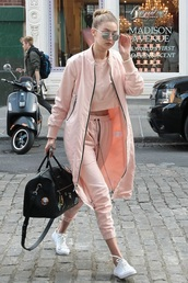 jacket,celebrity,gigi hadid,pink,coral,shoes,coat,crop tops,pants,top,sweats,sunglasses,bag,grunge,style scrapbook,bomber jacket,all pink everything,monochrome outfit