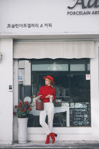 my blonde gal blogger sweater bag pants hat socks shoes fall outfits white pants ankle boots red boots red hat
