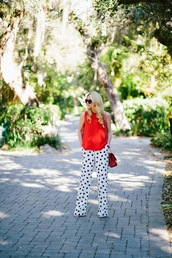 atlantic pacific,blogger,wide-leg pants,red top,polka dots,pants,top,bag,shoes,sunglasses,polka dot pants,red bag,shoulder bag,black sunglasses