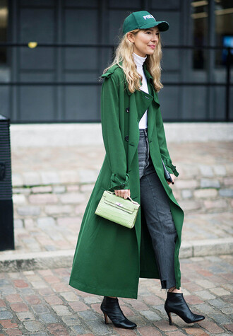 coat london fashion week 2017 fashion week 2017 fashion week streetstyle green green coat green long coat long coat top white top white turtleneck top turtleneck cap denim jeans grey jeans boots black boots ankle boots high heels boots bag