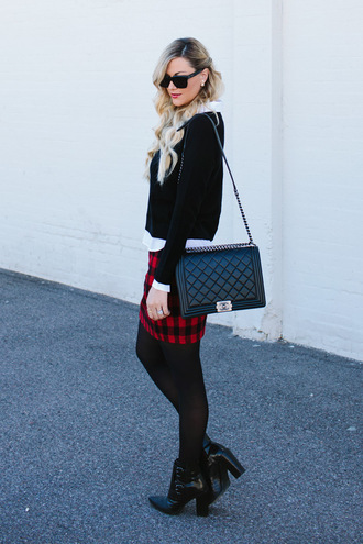 a little dash of darling blogger flannel quilted bag black heels rebecca minkoff black sweater chanel chanel bag black boots opaque tights mini skirt and ankle boots