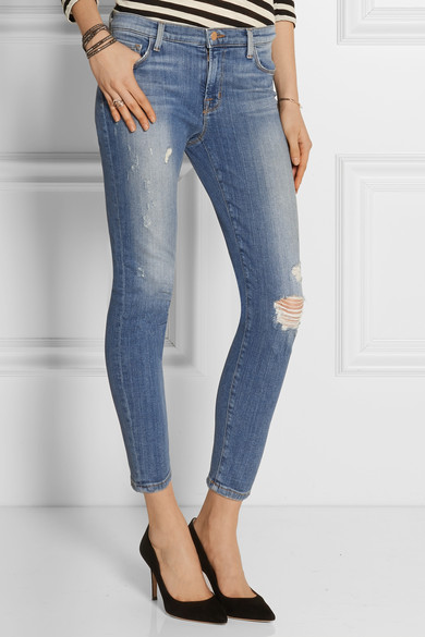 Rise distressed skinny jeans