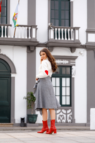 the mysterious girl skirt blogger shoes sweater boots red boots grey skirt