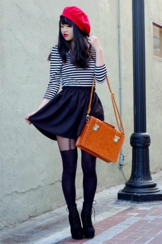 hat black and white striped shirt black skirt orange bag blogger red beret tall black heeled boots