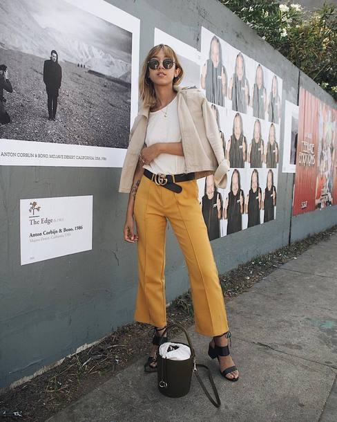 pants yellow yellow pants cropped pants t-shirt white t-shirt sandals sandal heels bag jacket nude jacket sunglasses