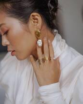 jewels,pearl earrings,hand jewelry,ring,earrings,white turtleneck top