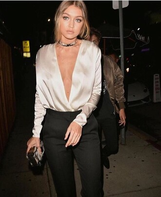 blouse silk plunge v neck long sleeves silver metallic blouse satin shirt top gigi hadid celebrity celebrity style v neck silk top white top necklace choker necklace pants black pants clutch outfit gigi hadid style nightwear model victoria's secret model beautiful jewels jewelry shirt