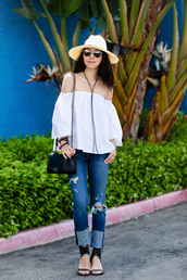fit fab fun mom,blogger,sunglasses,hat,bag,jewels,off the shoulder,white top,black bag,ripped jeans,skinny jeans,flats,white off shoulder top,off the shoulder top,straw hat,sun hat,chanel,chanel style jacket,chanel bag,chanel boy,shoulder bag,blue jeans,sandals,mid heel sandals,black sandals,spring outfits,necklace