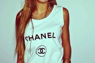tank top shirt chanel t-shirt yolo hipster mainstream wanted chanel t-shirt swag girl swag swaggie coco chanel muscle tank muscle tee white tank top top white long hair tee no sleeved no sleeves white t-shirt white top chanel brand necklace gold necklace girl style blouse