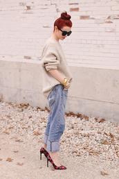 sea of shoes,blogger,bun,oversized sweater,red heels,boyfriend jeans,sweater,jewels,shoes,jeans,top knot bun