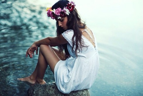 white long hair waves jewels summer dress ocean pink flowers flower crown crown yellow purple red white dress lace detail deep v back v back dress rocks