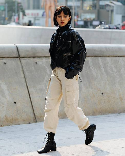 jacket black jacket vinyl pants wide-leg pants pockets boots turtleneck earrings chain necklace cargo pants black boots bomber jacket black t-shirt