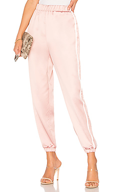 by the way. Nola Double Strip Track Pant in Mauve from Revolve.com