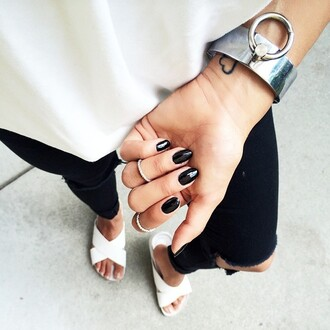 jewels black nails slide shoes white shoes flats black ripped jeans cuff bracelet silver jewelry dark nail polish outfit idea black and white minimalist tumblr bracelets nail polish nails knuckle ring ring