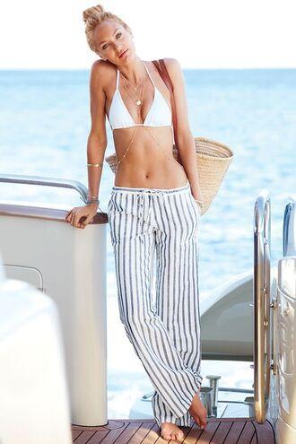 jewels body chain gold body chain summer outfits lazy day candice swanepoel boho pants bikini top white swimwear striped pants wide-leg pants jewelry model