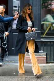 pants,streetstyle,work outfits,chrissy teigen,yellow